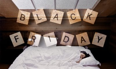 Black Friday Banner and Woman Sleeping in Bed