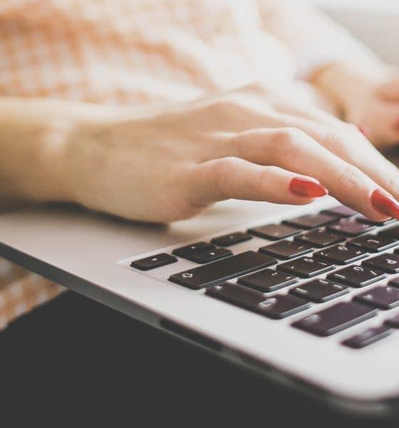 Woman Typing on :aptop