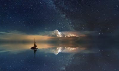 Sailboat Floating at Night