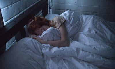 Woman Sleeping in Comfy White Sheets